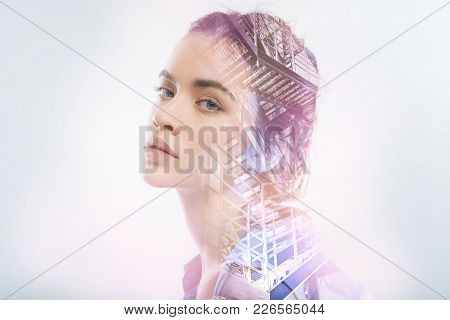Magnetic Glance. Young Beautiful Calm Woman Looking Amazing While Sitting And Looking Into The Dista