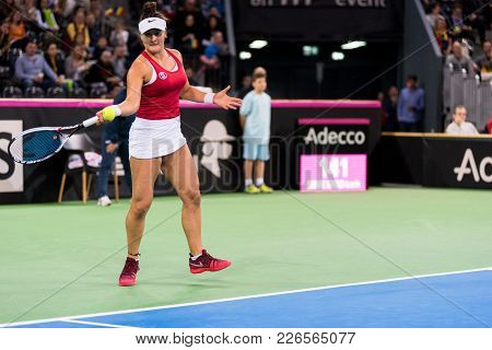 Professional Woman Tennis Player Playing A Game