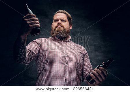 Portrait Of A Fat Bearded Male Holds Beer Bottles.
