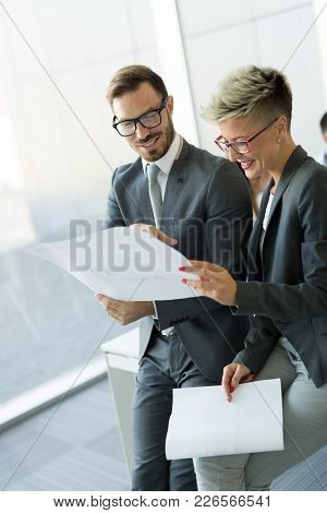 Picture Of Attractive Business Colleagues Talking In Office