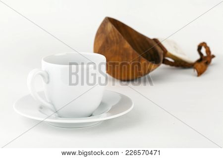 White Espresso Cup This Side Isolated On White. Brown Wooden Handicraft Made Guksi, Cup In The Backg