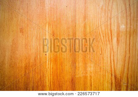 The Background Of The Wooden Varnished Surface With The Patterns Of Wood Fibers Appearing Through Th