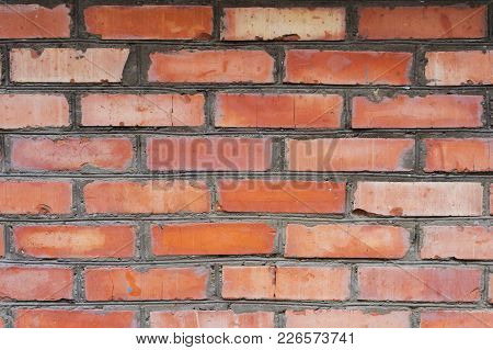 Textured Background Red Brick Wall With Traces Of Old Age And With Different Shades Of Bricks. Brick
