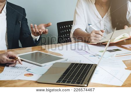 Business Team Meeting In An Office, Lawyers Or Attorneys Discussing A Document Or Contract Agreement