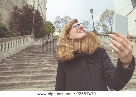 Cute Girl Using Cellphone On The Street.