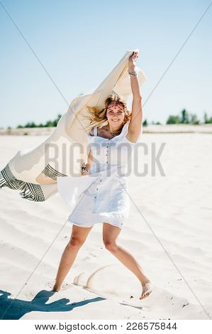 Portrait Of A Girl With A Blanket On Sand. Beautiful Stylish Sexy Young Girl Goes, Running Alongon S