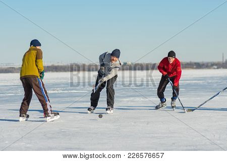 Dnepr, Ukraine - January 22, 2017: People Of Different Ages Playing Hockey On A Frozen River Dnepr I