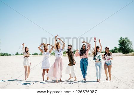 Beautiful Stylish Happy Sexy Slim Young Girls Danssing On Sand Beach. Party In Style Boho. Bachelore