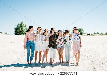 Stylish Happy Sexy Slim Young Hugging Girls Stand Sand Beach. Hands Decorated Buttonhole, Butonierka