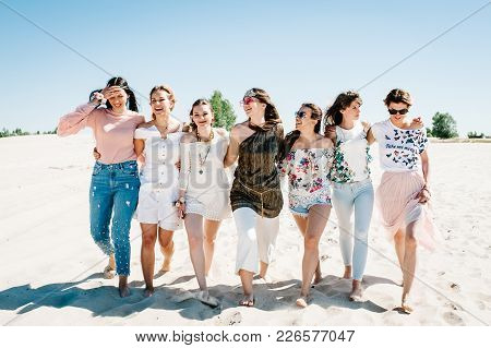 Stylish Happy Sexy Slim Young Hugging Girls Is Go Sand Beach. Party In Style Boho. Maiden Evening He