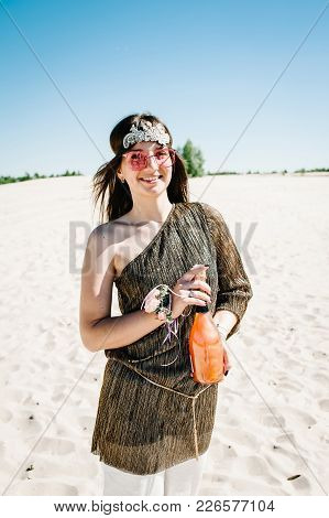 Girl Holds Champagne And Glass. Happy Slim Stylish Sexy Young Girl Sand Beach. Glass, Hand Decorated