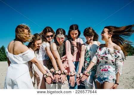 Beautiful Happy Stylish Sexy Young Girls On Beach Show Hands Whis Decorating Boutonniere Of Flowers