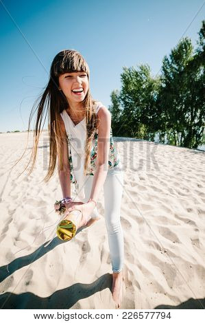 Beautiful Happy Stylish Sexy Young Girl Stand In Beach And Opens Colored Confetti On Background Natu