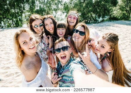 Beautiful Happy Stylish Sexy Young Girls With Man Stand On Sand Beach On Background Nature. Party  S