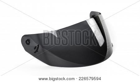 Black Visor For The Helmet. Tinted Glass For The Helmet. Close Up. Isolated On A White Background.