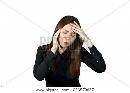 Girl On A White Background Suffers From A Headache, Holding Her Hands Behind Her Head