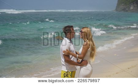 Beautiful Couple Embracing Each Other Stands On The Beach And Looks At The Sea.relationships, Beach,