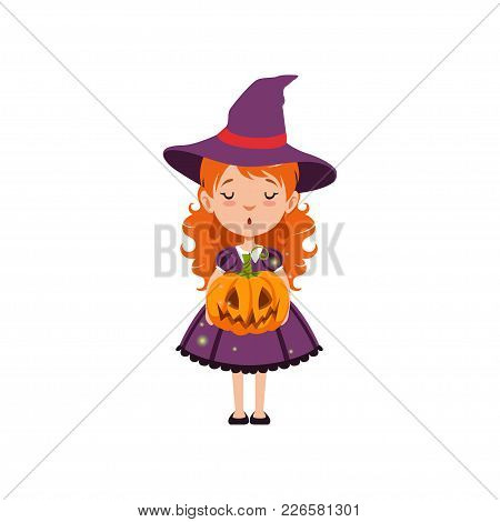 Adorable Young Red-haired Girl Witch Standing With Pumpkin Face In Her Hands And Wearing Purple Dres