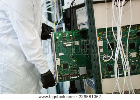 Picture Of Technician Engineer Repairing Cmts Networking Cards