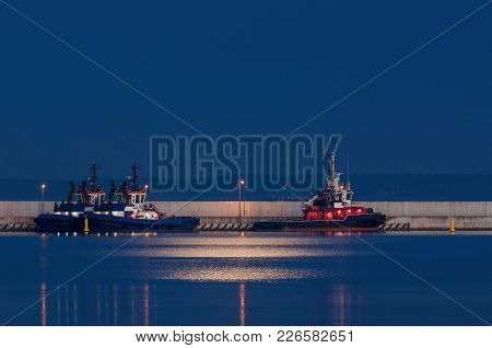 Fireboat And Tugs - Auxiliary Ships Sleep At The Quay On A Moonlit Night