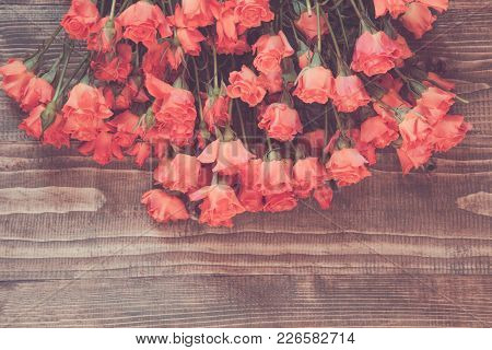 Bouquet Of Orange Roses On Wooden Board. Spring Pattern And Copy Space. Vintage Matte