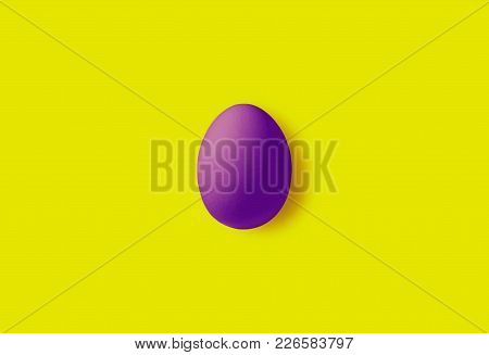 One Egg On A Yellow Background.  Minimalism Style