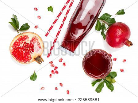 Top View Of Pomegranate Juice In A Bottle And Pomegranate Fruits Isolated On White Background.