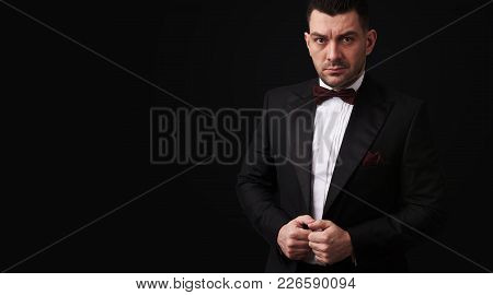 Elegant Young Fashion Man In Tuxedo