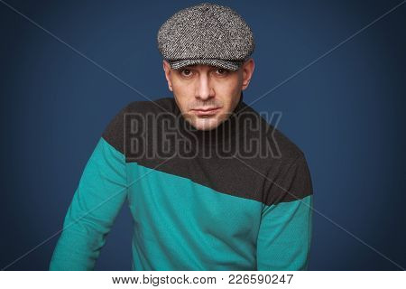 Portrait Of A Man With Flat Cap.