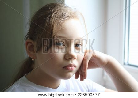Portrait Of 12-years Old Girl At Home Near Window, Close Up