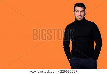 Onfident Young Handsome Man In Turtleneck Sweater