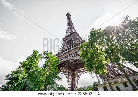 Ultra Wide Angle Of Eiffel Tower In Paris, France. Worms Eye View View With Back Light