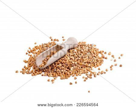 A Natural Raw Heap Of Buckwheat Groats Isolated On White Background. Cereal Is A Useful Food Ingredi