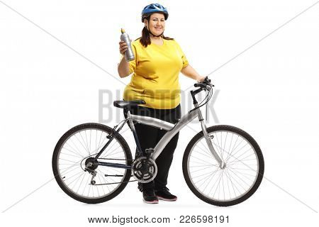 Full length portrait of an overweight woman with a bicycle and a water bottle isolated on white background
