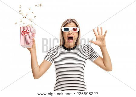Terrified young woman with 3D glasses and popcorn isolated on white background