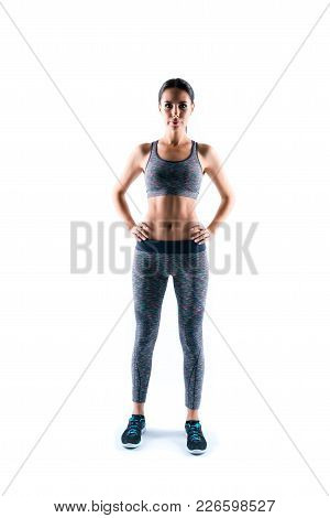 Vertical Full-size Full-lenght Portrait Of Confident Concentrated Serious Beautiful Sporty Woman's F