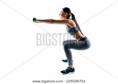 Side Profile View Portrait Of Beautiful Happy Cheerful Healthy Sporty Woman Holding Dumbbells And Sq