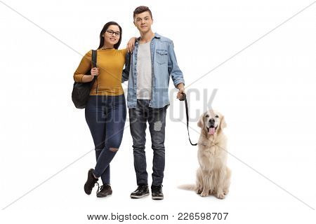 Full length portrait of teenage students with a labrador retriever dog isolated on white background