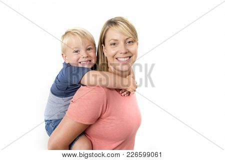 Young Happy Woman Carrying Her Adorable 3 Years Old  Little Boy On Her Back Smiling Happy And Cheerf