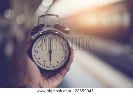 Alarm Clock Handles At The Train Station For Compare Time Train Out Of The Station
