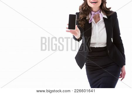 Cropped Image Of Laughing Stewardess Showing Smartphone With Blank Screen Isolated On White