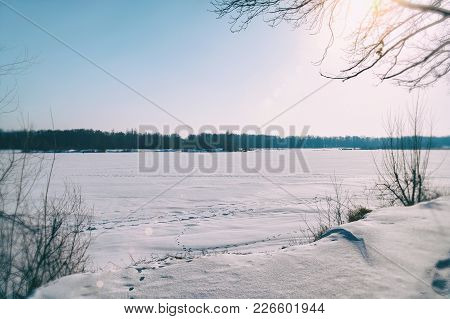Winter Landscape. Snow-covered Lake In The Distance Is The Beautiful Forest And Beautiful Fblue Sky