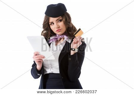 Attractive Thoughtful Stewardess With Tablet And Credit Card Isolated On White