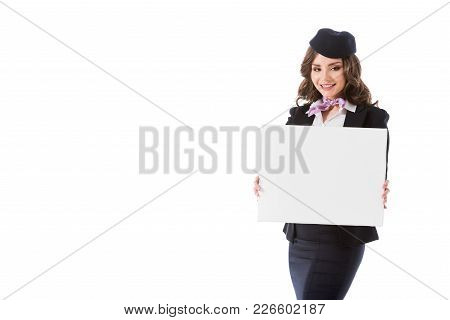 Smiling Attractive Stewardess Holding Empty Board Isolated On White