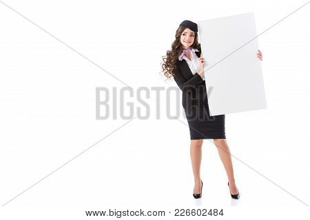 Attractive Stewardess Showing Empty Board Isolated On White