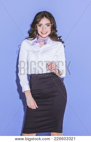 View Of Smiling Attractive Stewardess Posing On Purple