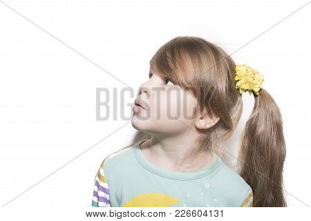 Little Emotional Girl With Astonishment Looks Upwards Isolated On White Background For All Purposes