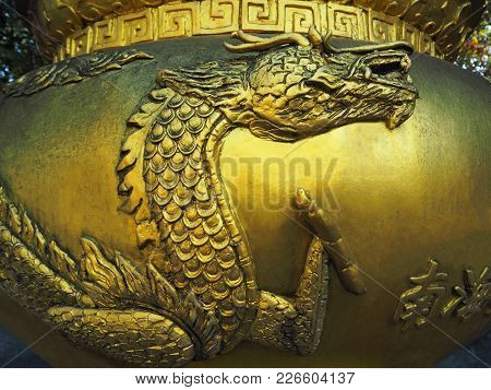 Exotic Golden Dragon On The Chinese Incense Pot Inside The Shrine (displaying To Public And Allowed