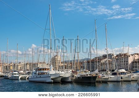Marseille, France - December 4, 2016: Cityscape With Moored Yachts And Boats In Old Vieux Port Of Ma