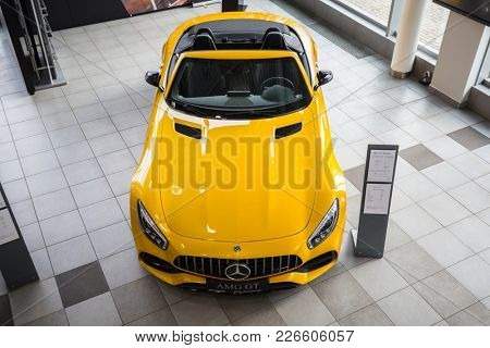 GDANSK, POLAND - FEBRUARY 13, 2018: Yellow Mercedes GT C Roadster in the car showroom of Gdansk, Poland. Mercedes GT C a 2-seater fastback roadster produced by Mercedes-AMG